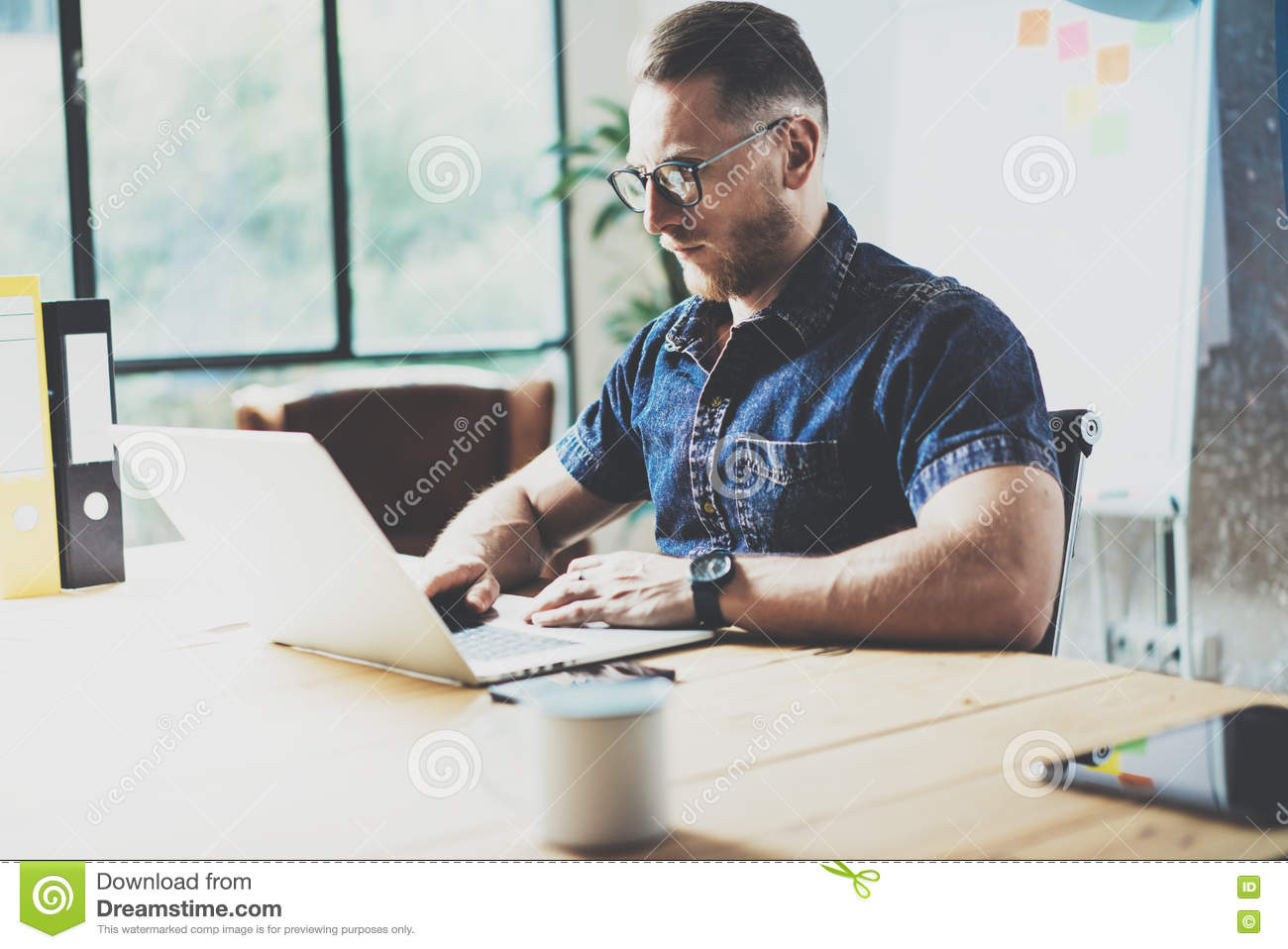Bearded Graphic Designer Working Wood Table Laptop Modern Interior