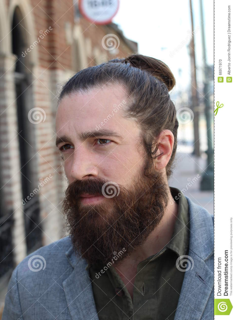 Bearded Hipster Model With Man Bun Hairstyle Stock Photo