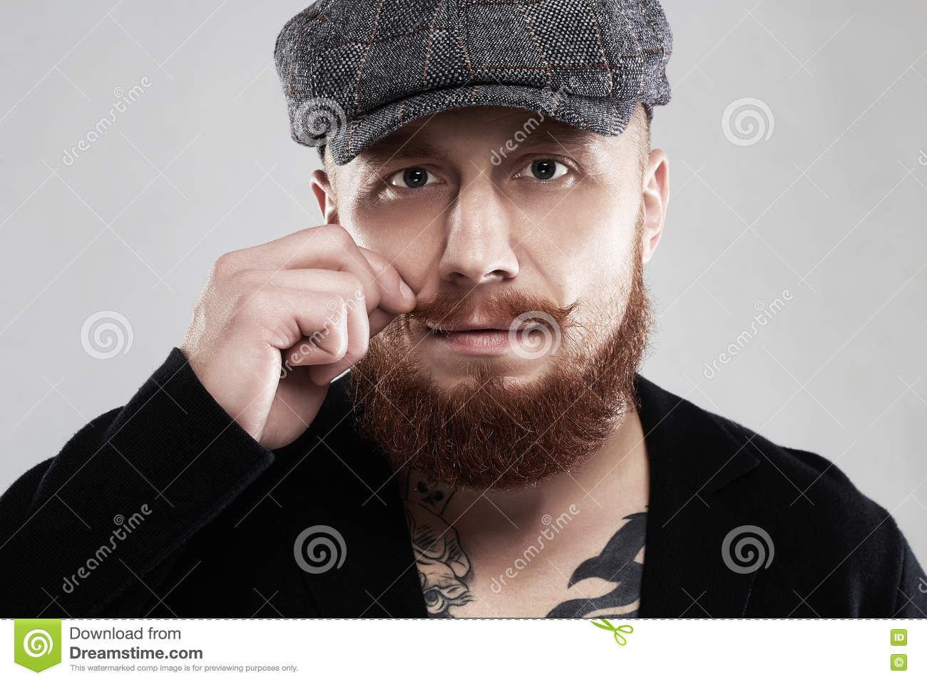 b5caabceb11 Bearded hipster with tattoo.brutal handsome boy in hat. Download preview