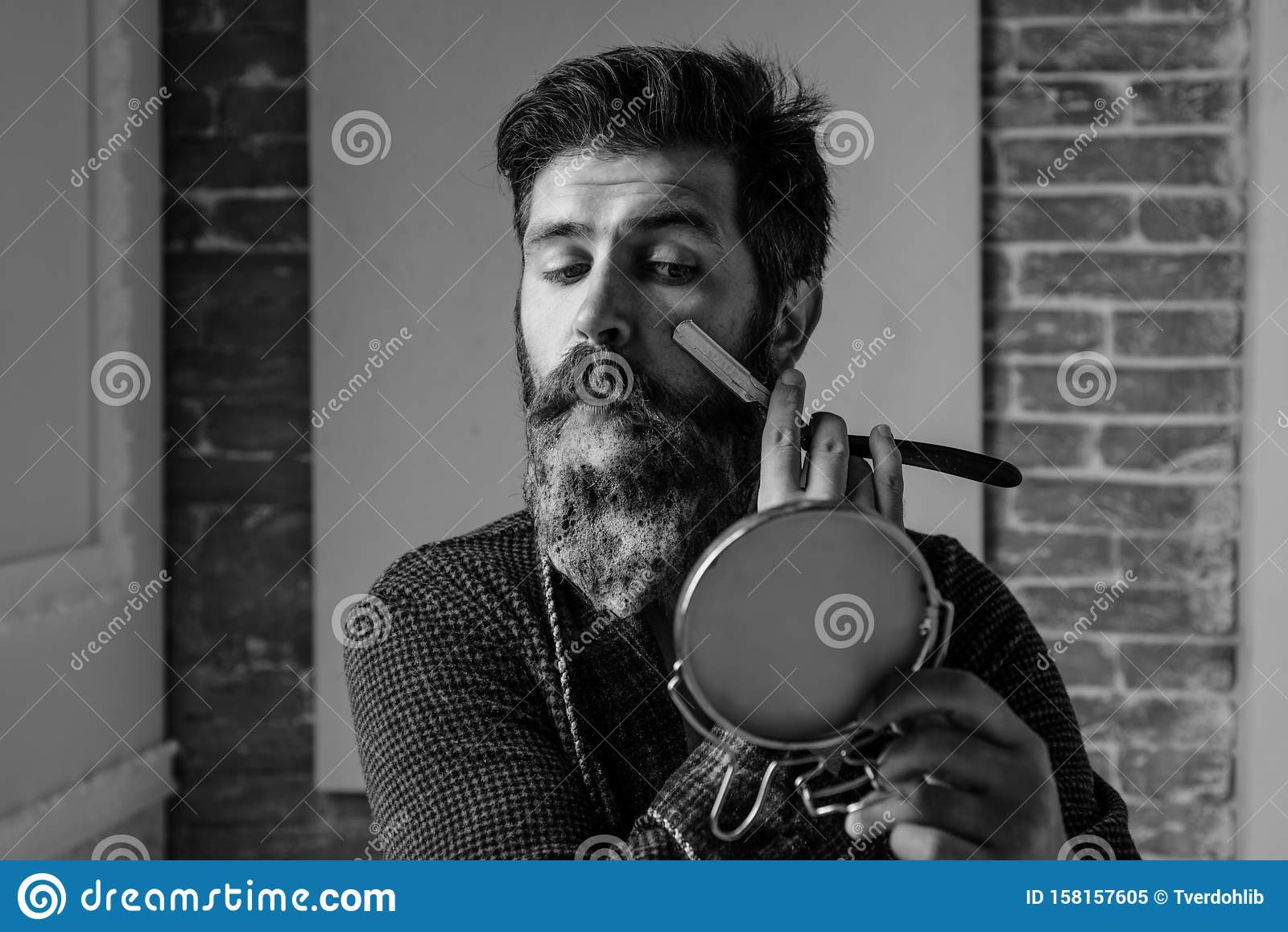 Bearded man - home beard style. Portrait of stylish man beard. Barber straight razor, barbershop. Vintage barber shop