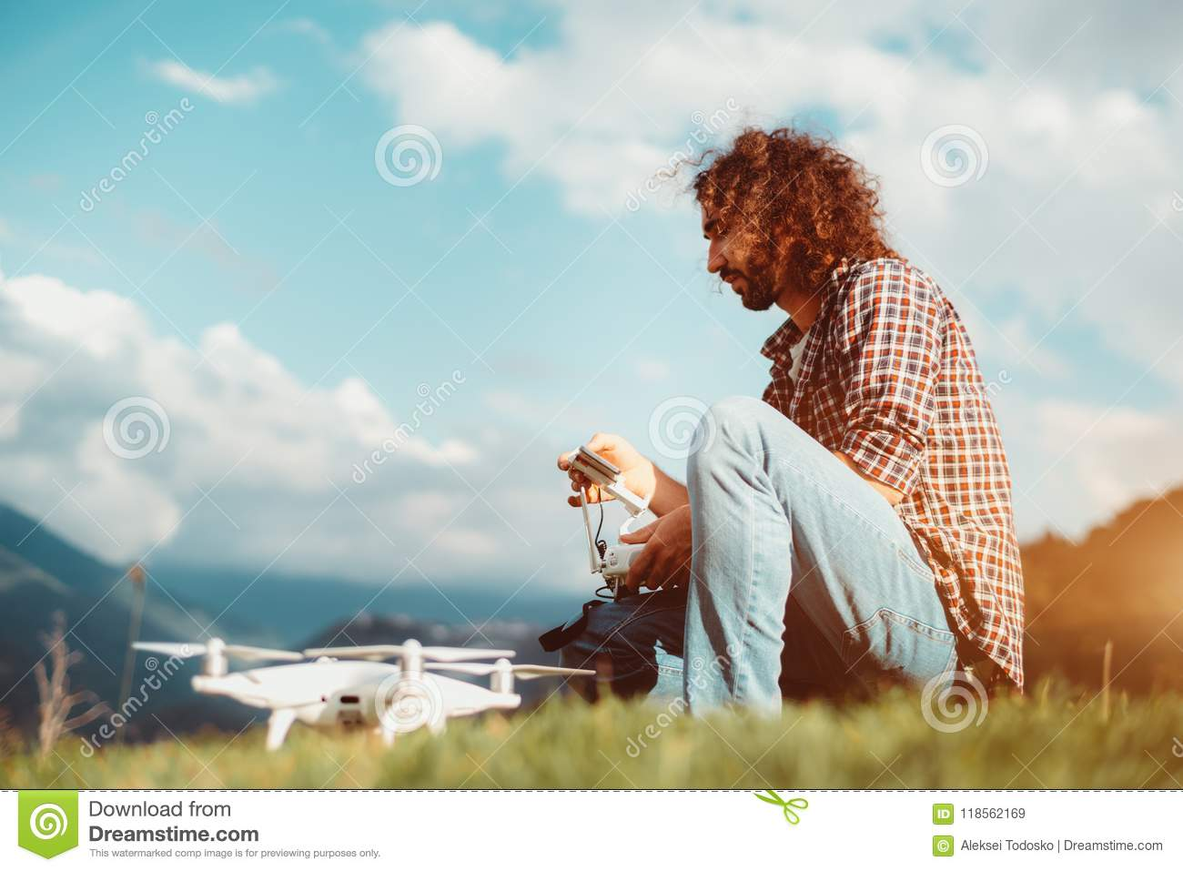 Bearded Man Is Programming His Drone Outdoors Before