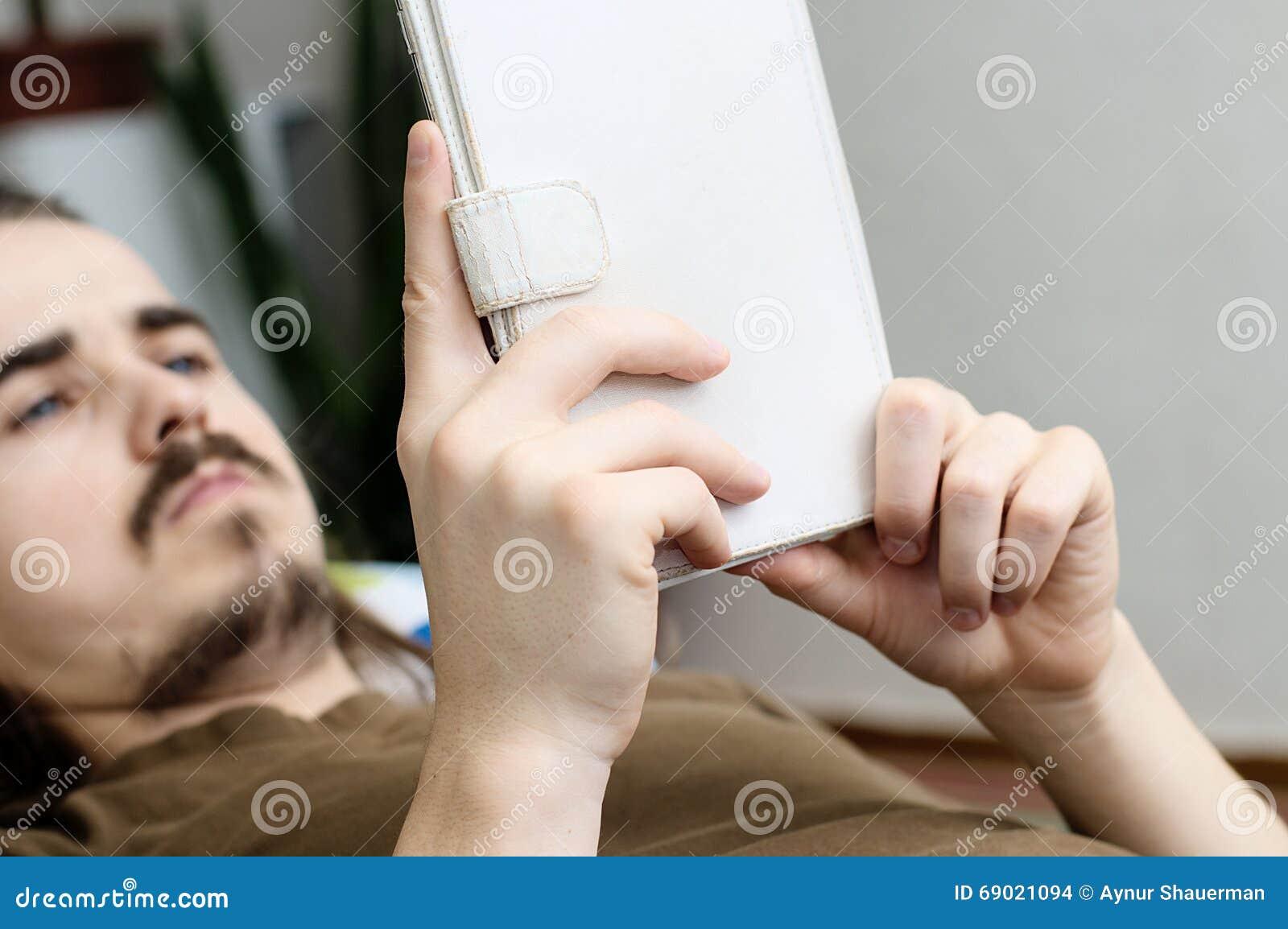 Bearded man reading ebook