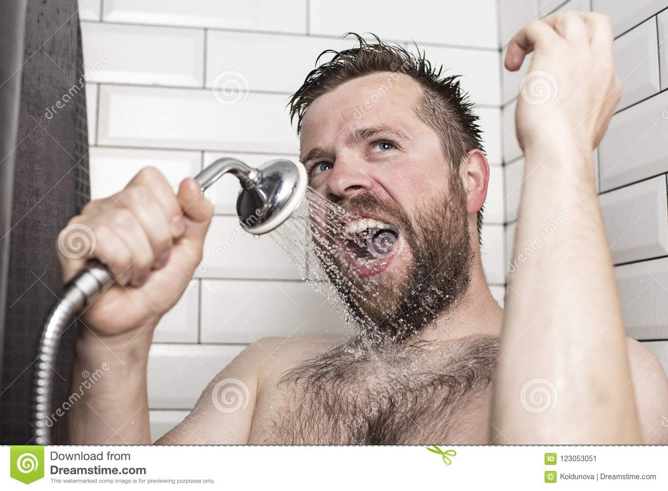 Bearded Man Singing In The Bathroom Using The Shower Head With F