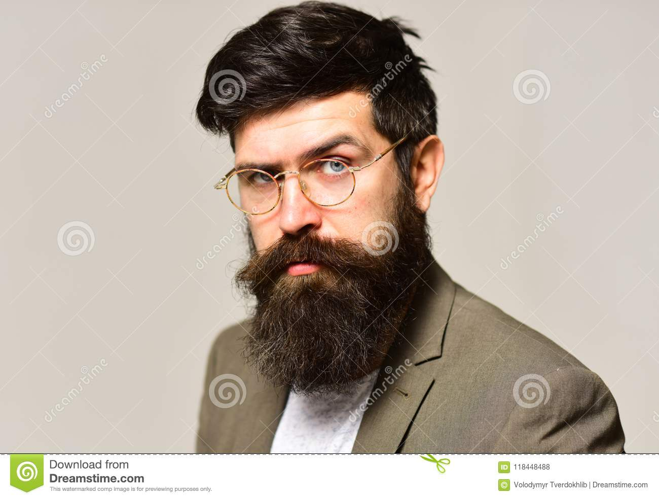 5aaf4cc3a07 Hipster with long beard and mustache on unshaven face. Businessman in suit.  Man teacher wear glasses with genius look. Fashion accessory and business  style.