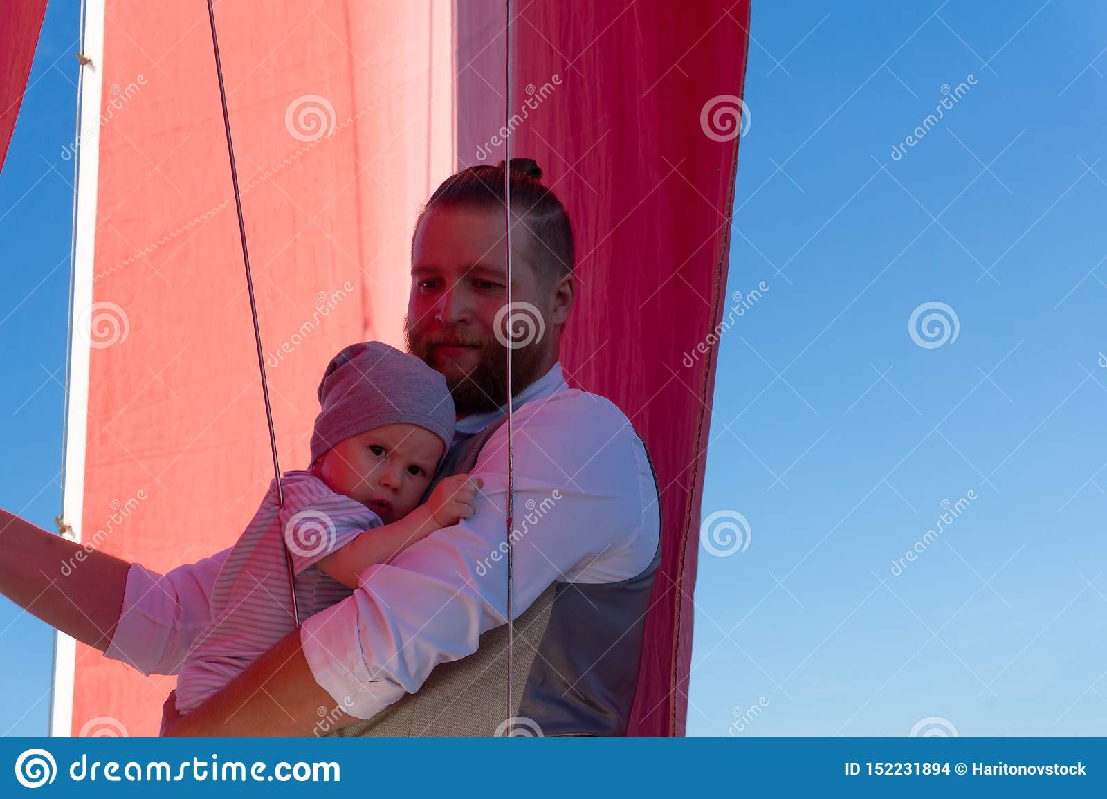 Man with a child on a sailing ship