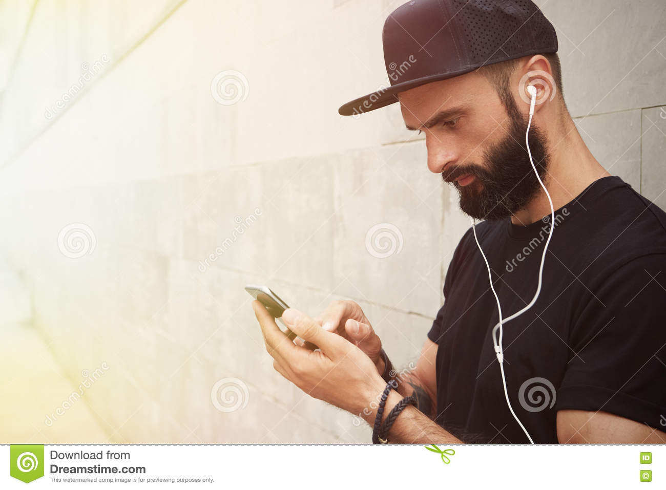 73795e4979c Bearded Muscular Man Wearing Black Tshirt Blank Snapback Cap Summer Time.Young  Men Standing Opposite Empty Gray Concrete Wall Background Using Smartphone  ...