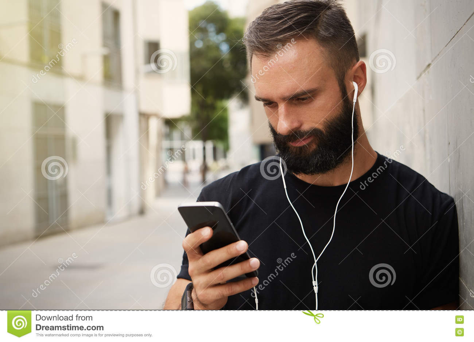 b564ddae38a Bearded Muscular Man Wearing Black Tshirt Blank Snapback Cap Summer Time.Young  Men Using Smartphone Headphones Looking Screen Smiling.Horizontal