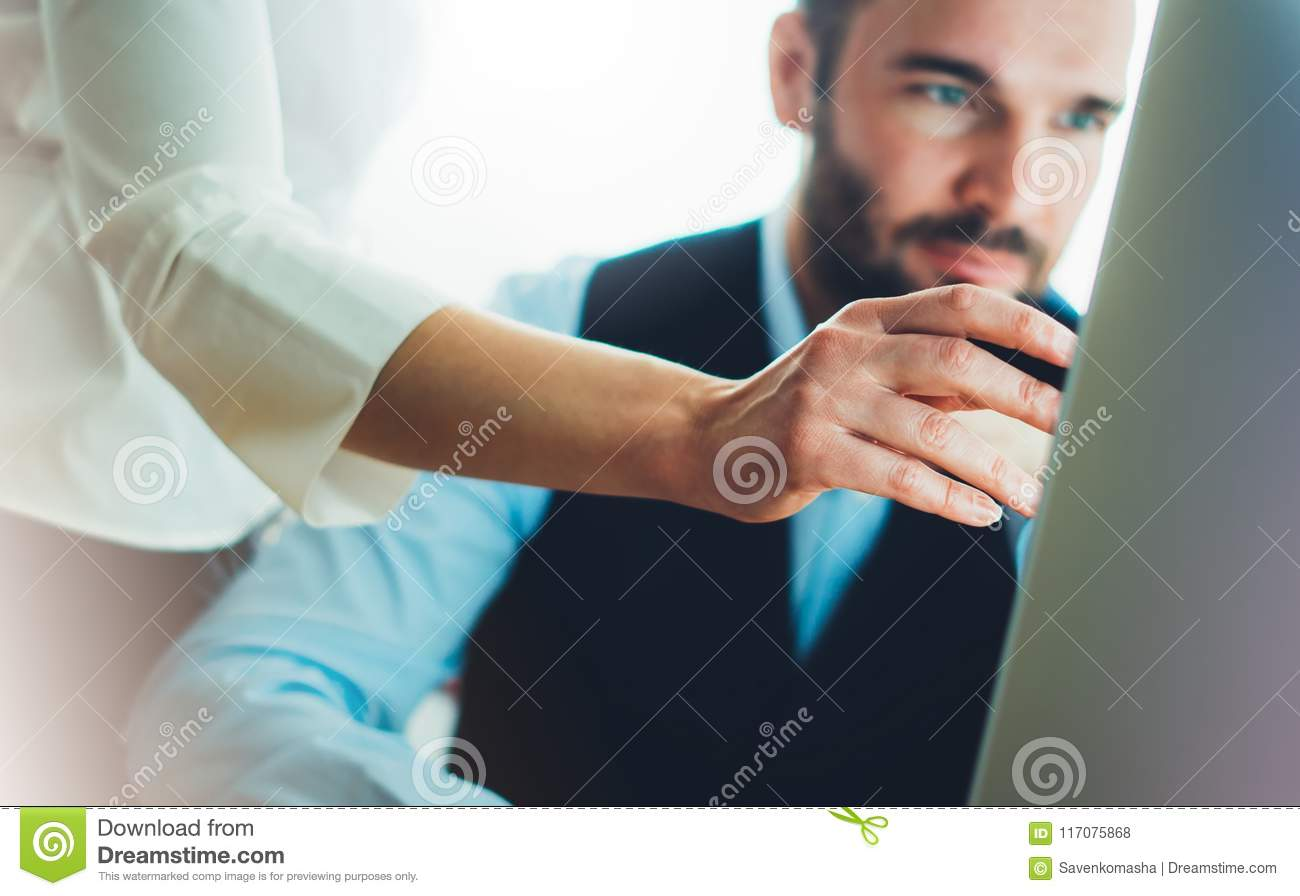 Bearded young businessman working on office. Director man thinking looking in monitor computer. Managers meeting. Idea, alalyze ma