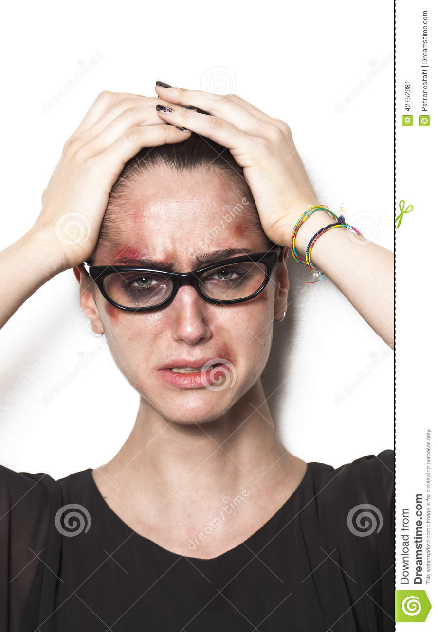 Beaten Up Girl Wearing Glasses And Crying Stock Photo