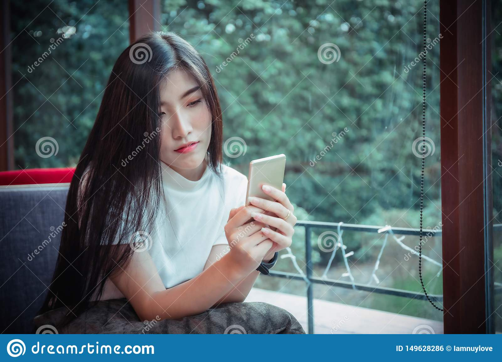 Beatiful asian girl`s holding mobile and have emotion happy looking at mobile phone