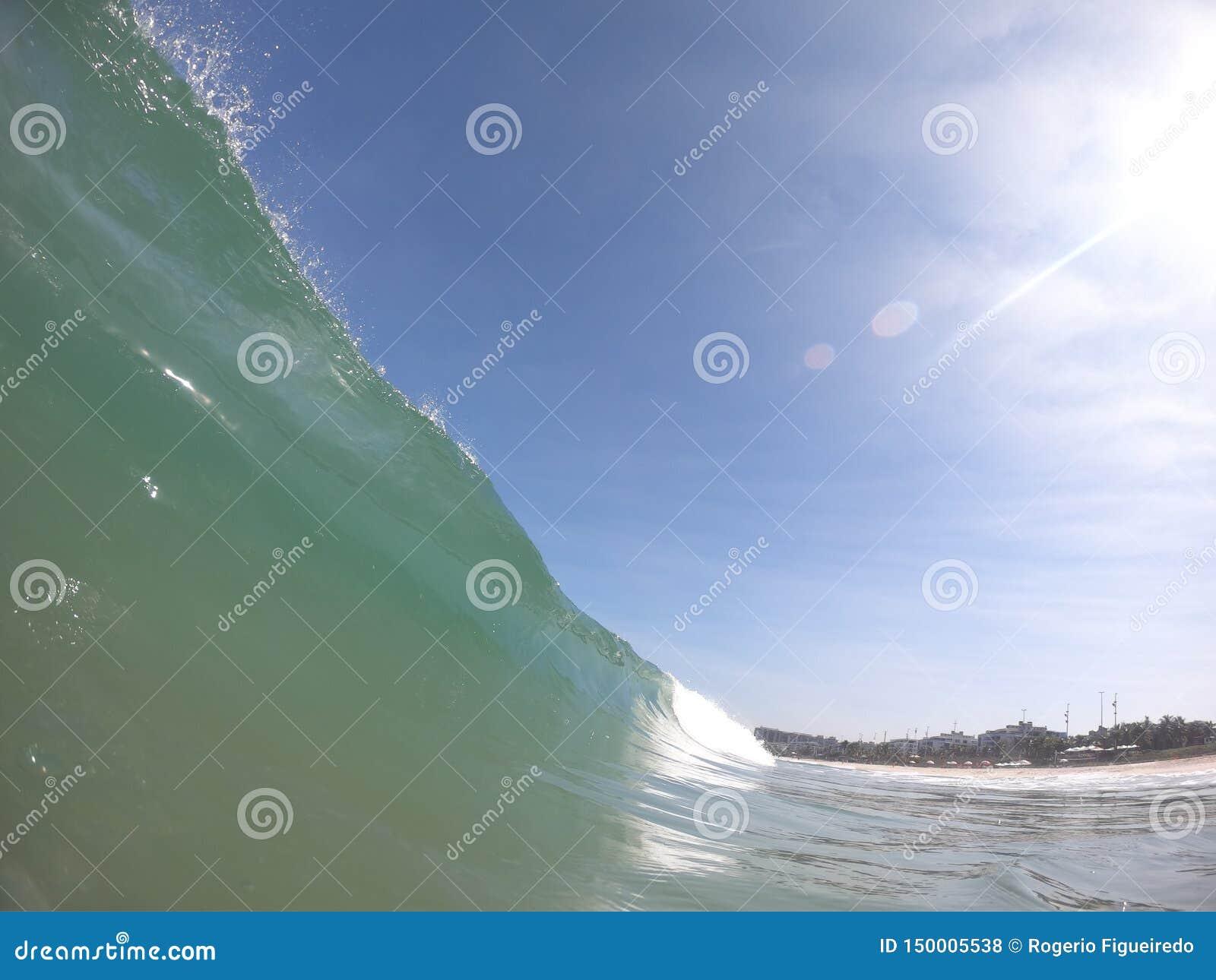 A beatiful wave in a sunny autumn day in Barra da Tijuca beach RJ