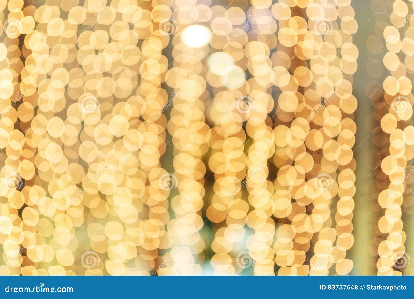 Beau bokeh de guirlande d or lumineuse de Noël
