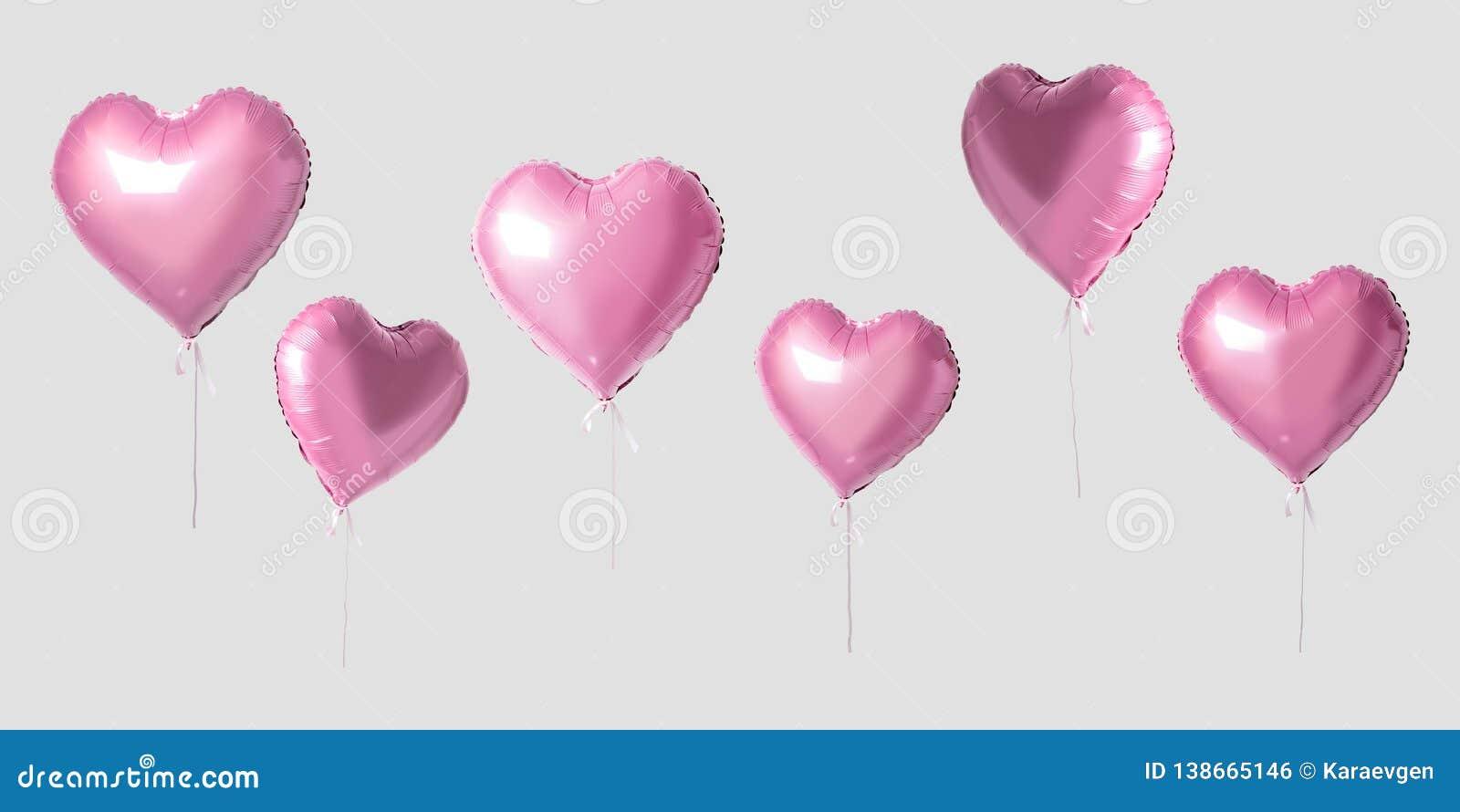 Beaucoup de ballons roses de coeur sur le fond lumineux Concept minimal d amour