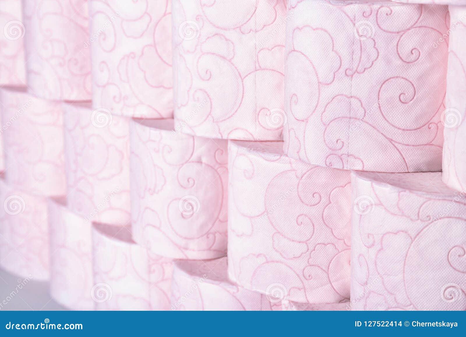 Beaucoup de rouleaux de papier hygiénique comme fond