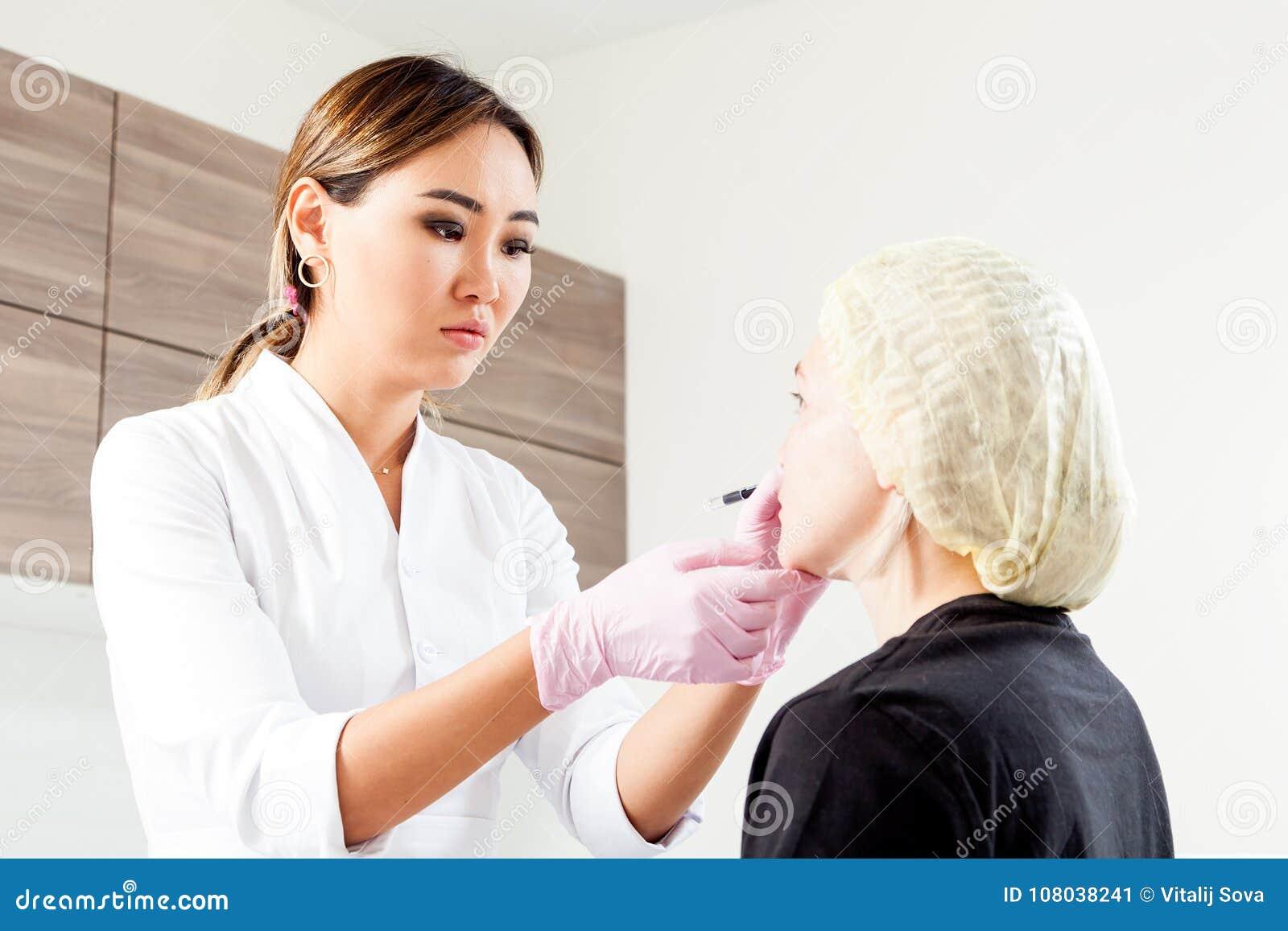 Beautician Pushes A Syringe To Inject Botox Stock Image - Image of