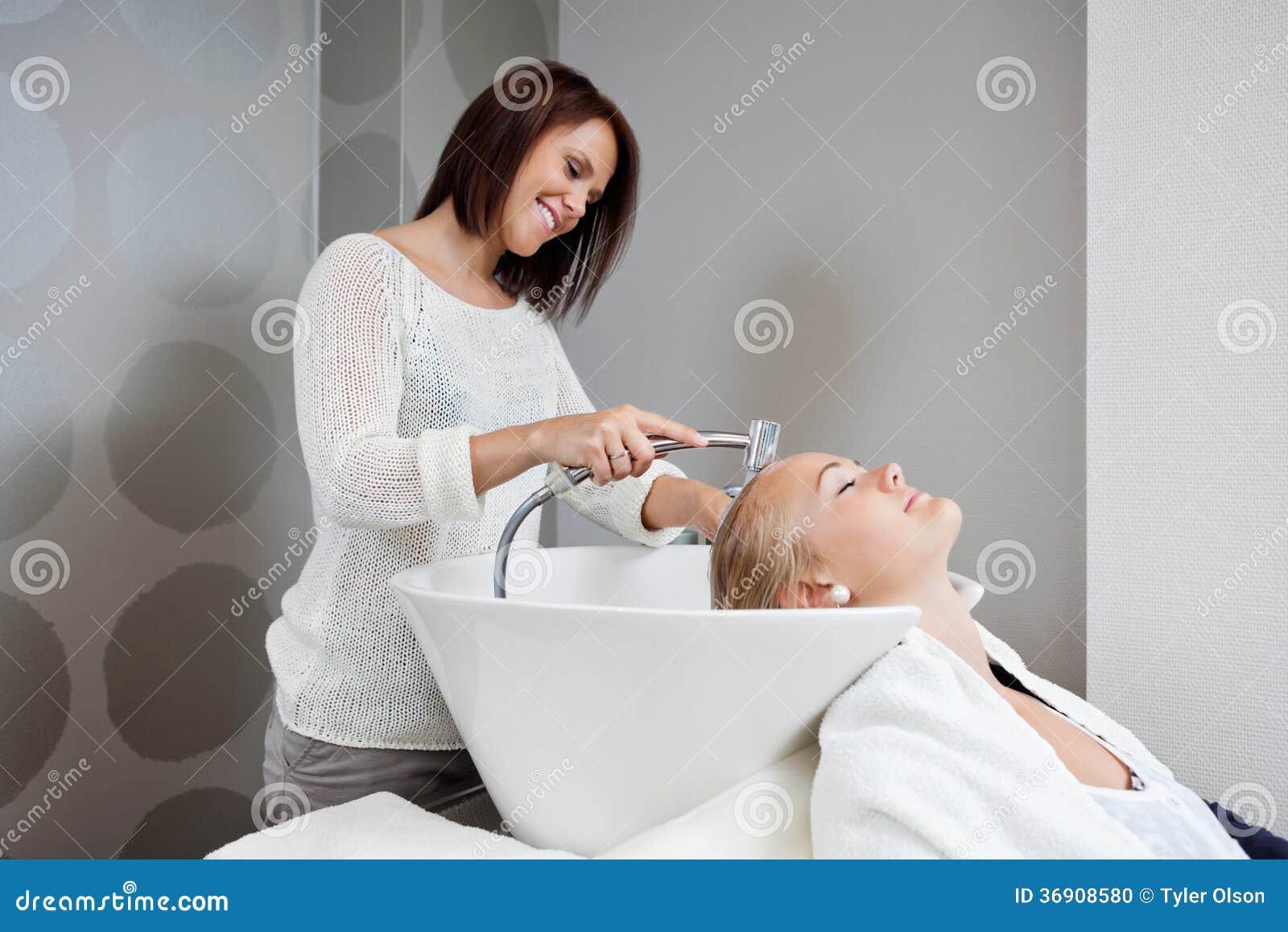 Beautician washing hair of customer stock photo image for Wash hair salon