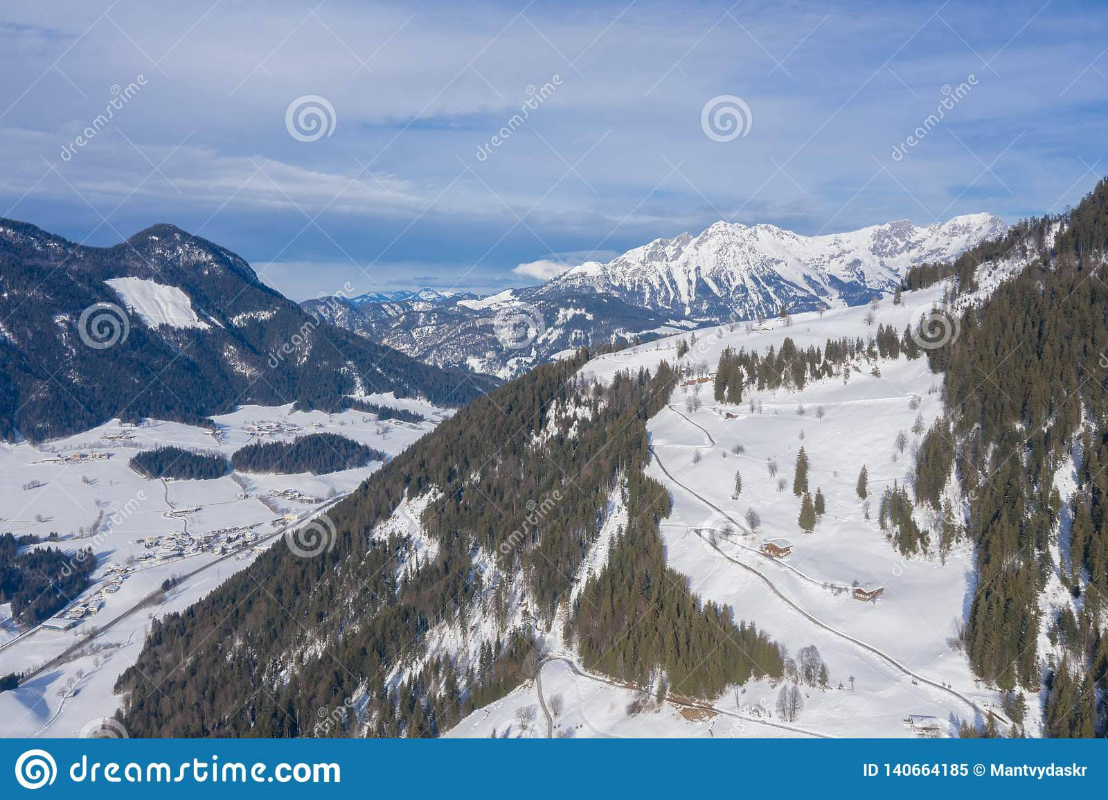 Beautiful aerial drone panorama of mountain valley, cottages and villages