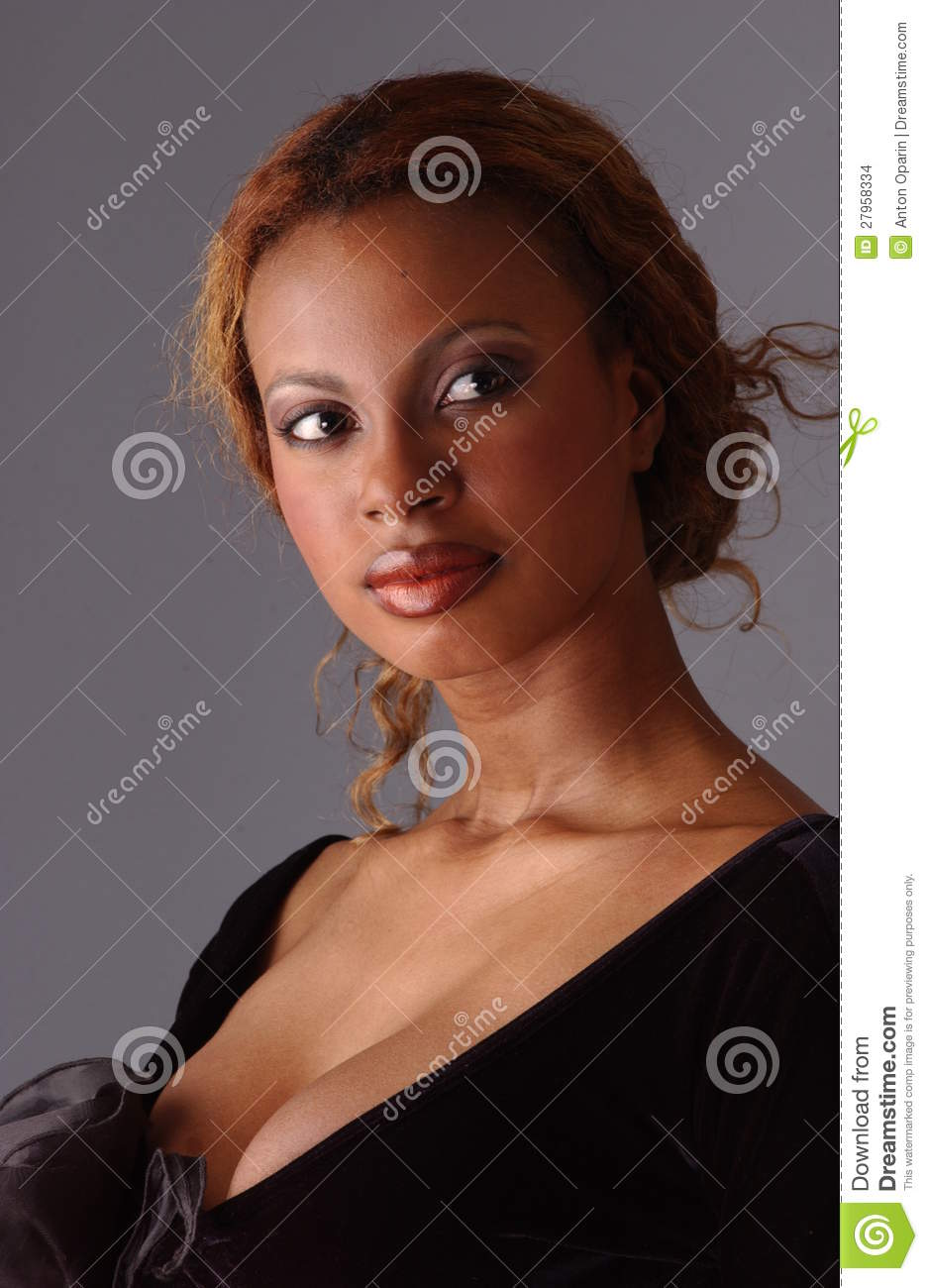 8b51e5aef7a Beautiful African American model posing wearing fashionable dresses