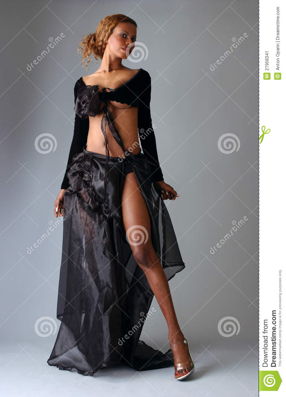 223fd4cac32 Beautiful African American model posing classy wearing fashionable dresses