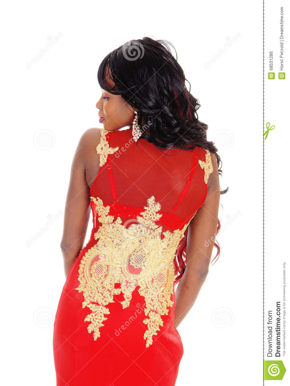 gorgeous African American woman standing in a long red evening ...