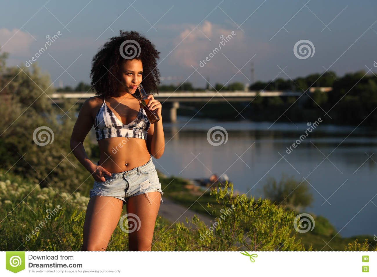 674c30248a70 Beautiful African Girl With Curly Hair Standing At A River Stock ...