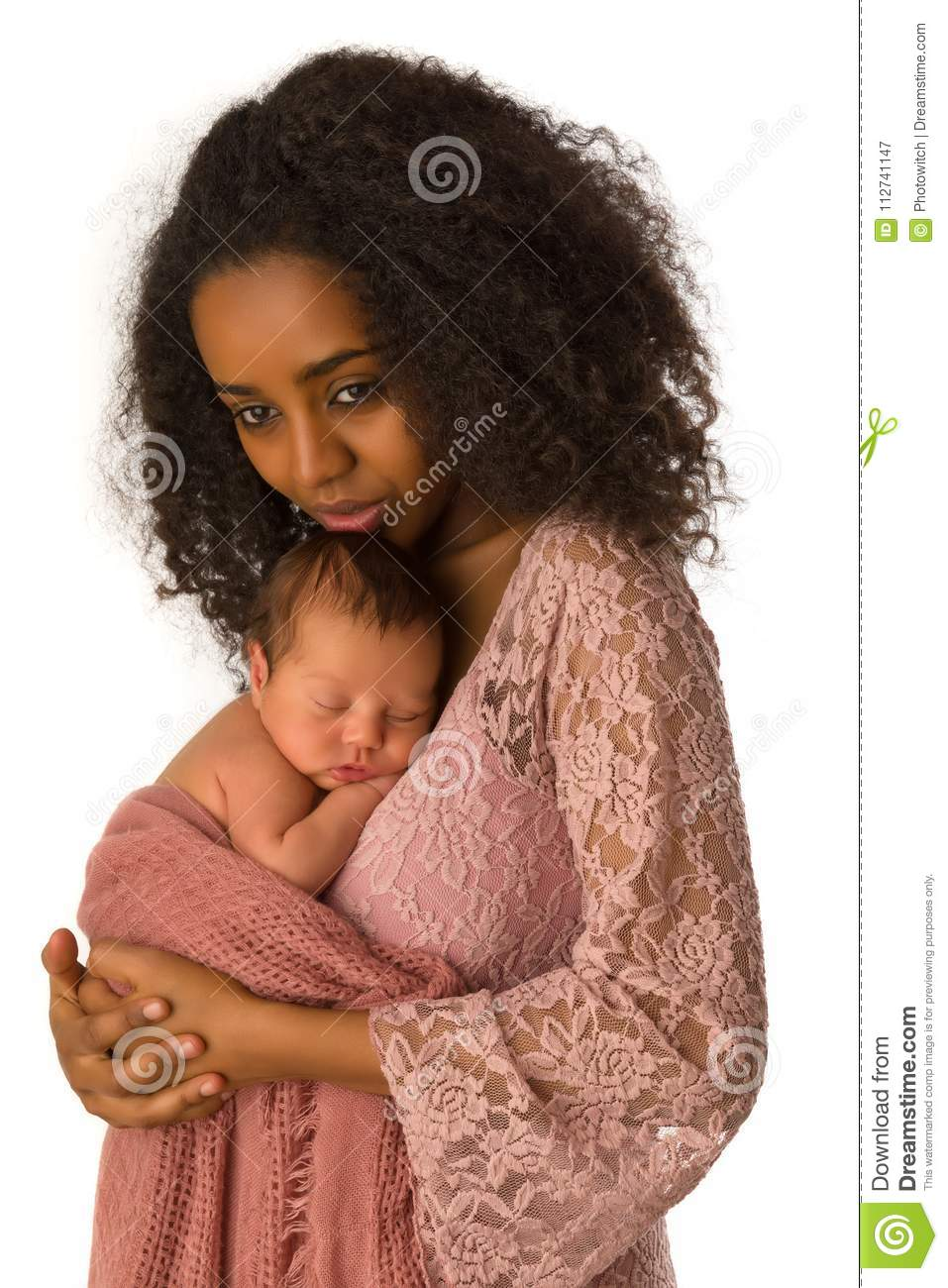 80aebccb2b3 Beautiful African mother in pink lace dress holding her 1 week old little  baby