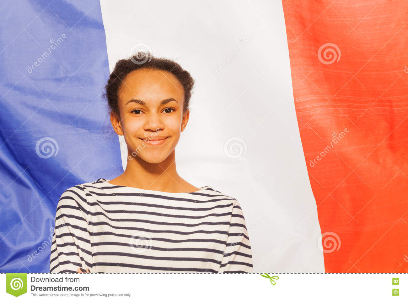 Beautiful African teenage girl with French flag