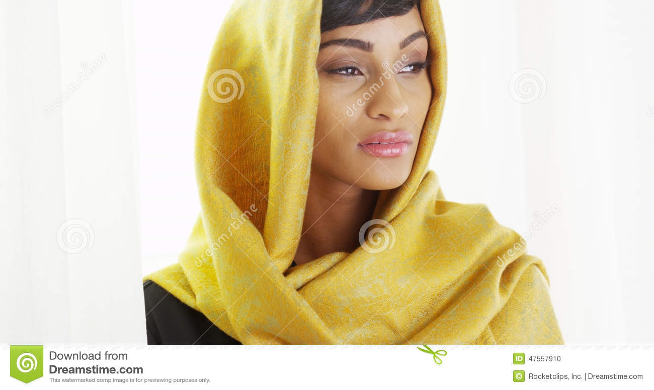 Beautiful African Woman Wearing Gold Head Scarf In Bright
