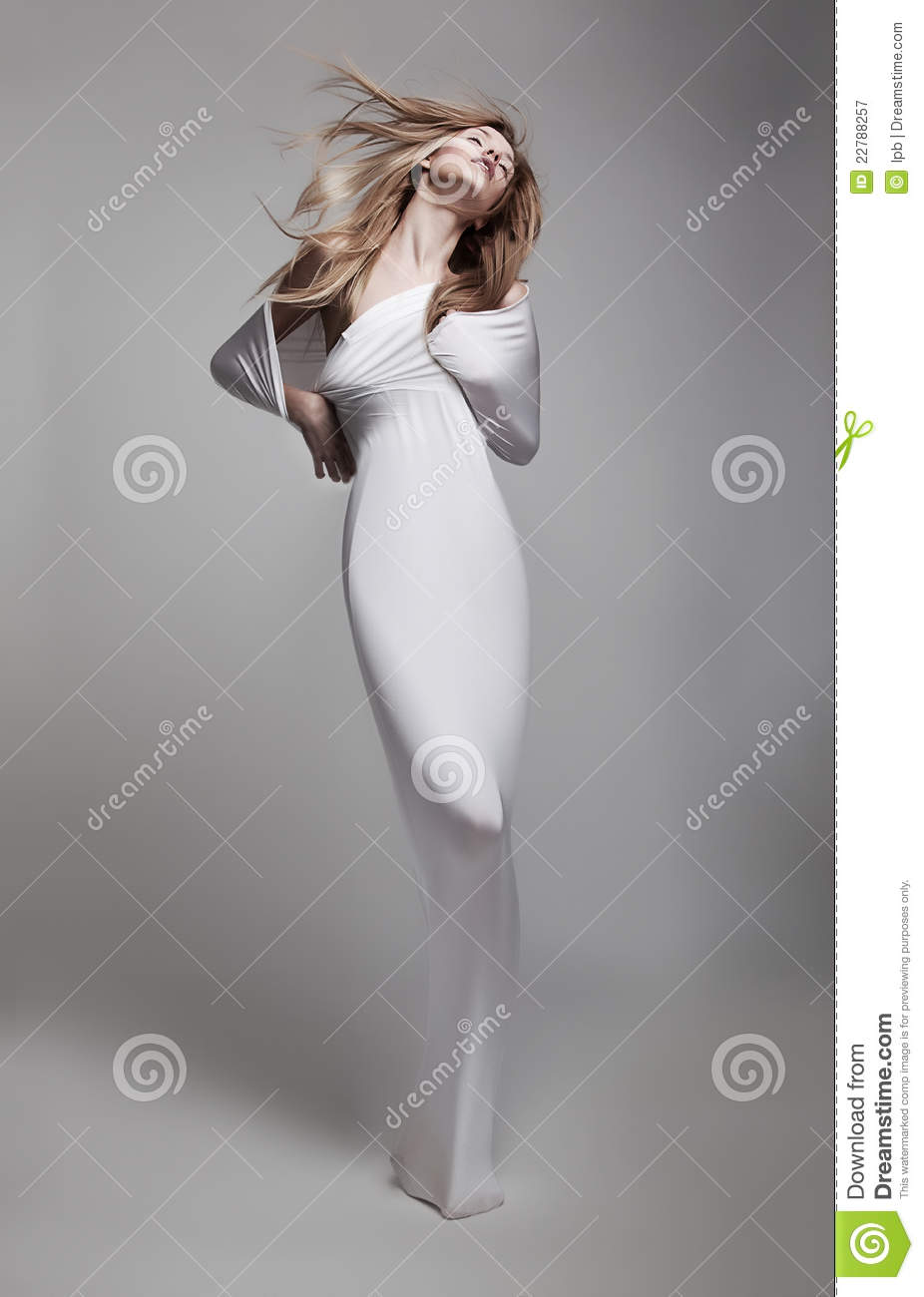 Beautiful airy young girl in white clothes