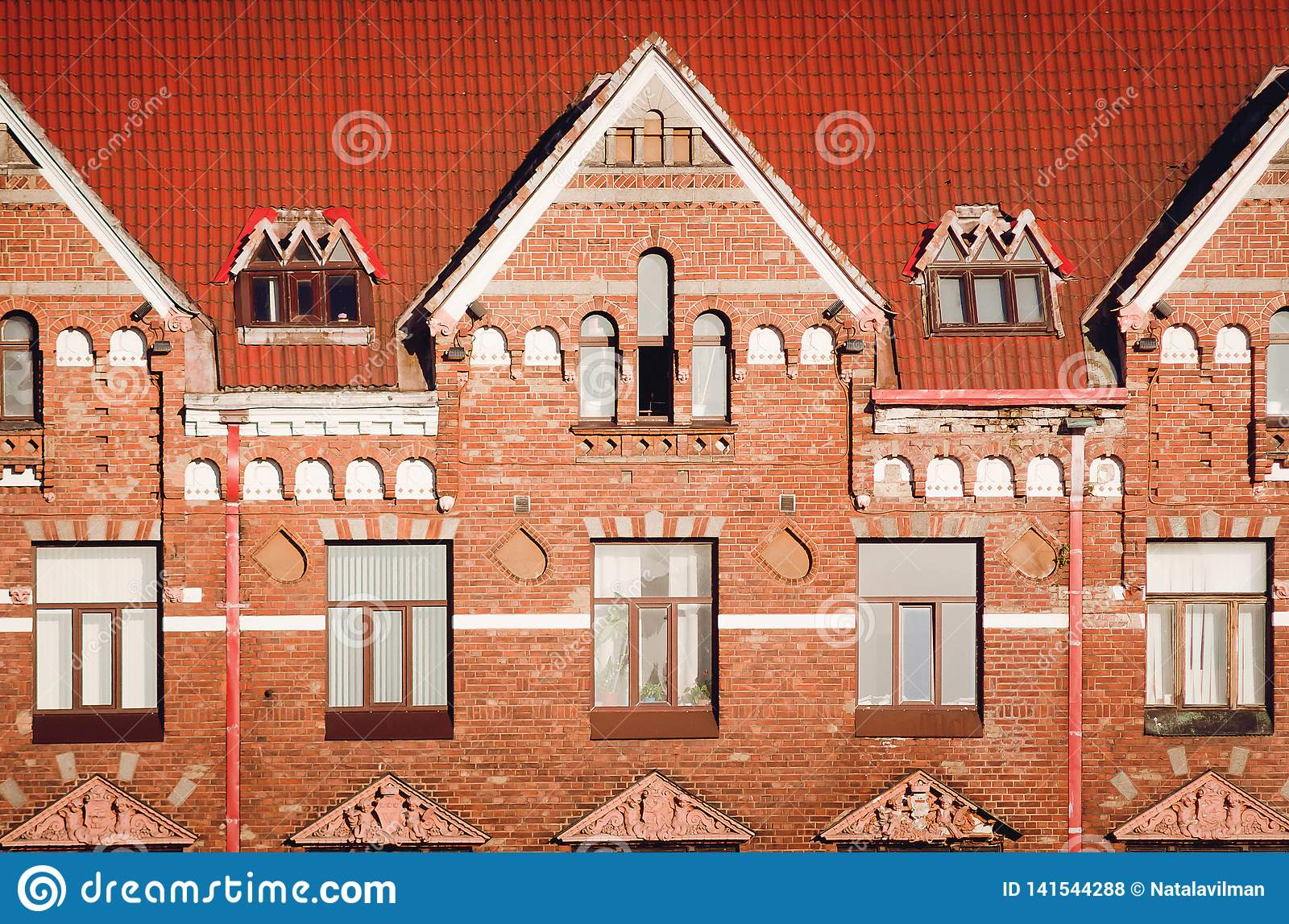 Beautiful ancient architecture of the city of Vyborg. Fragment of an old red brick building
