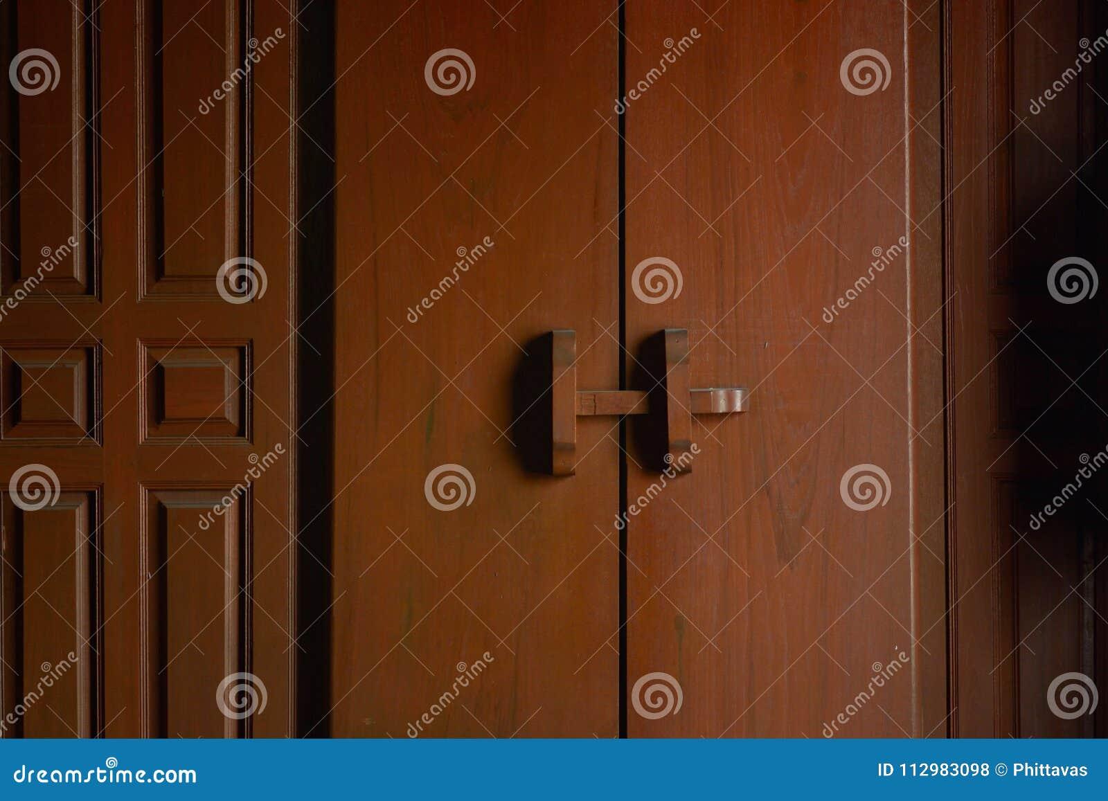 Beautiful ancient teak wood door in thai style