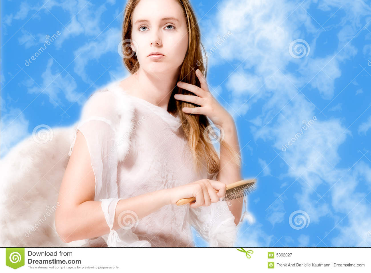 Beautiful angel in the clouds doing her hair