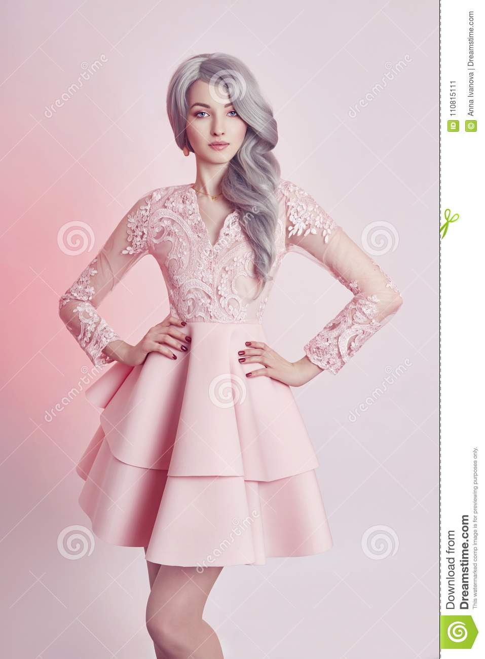 Beautiful anime doll girl in pink dress on pink background a gi