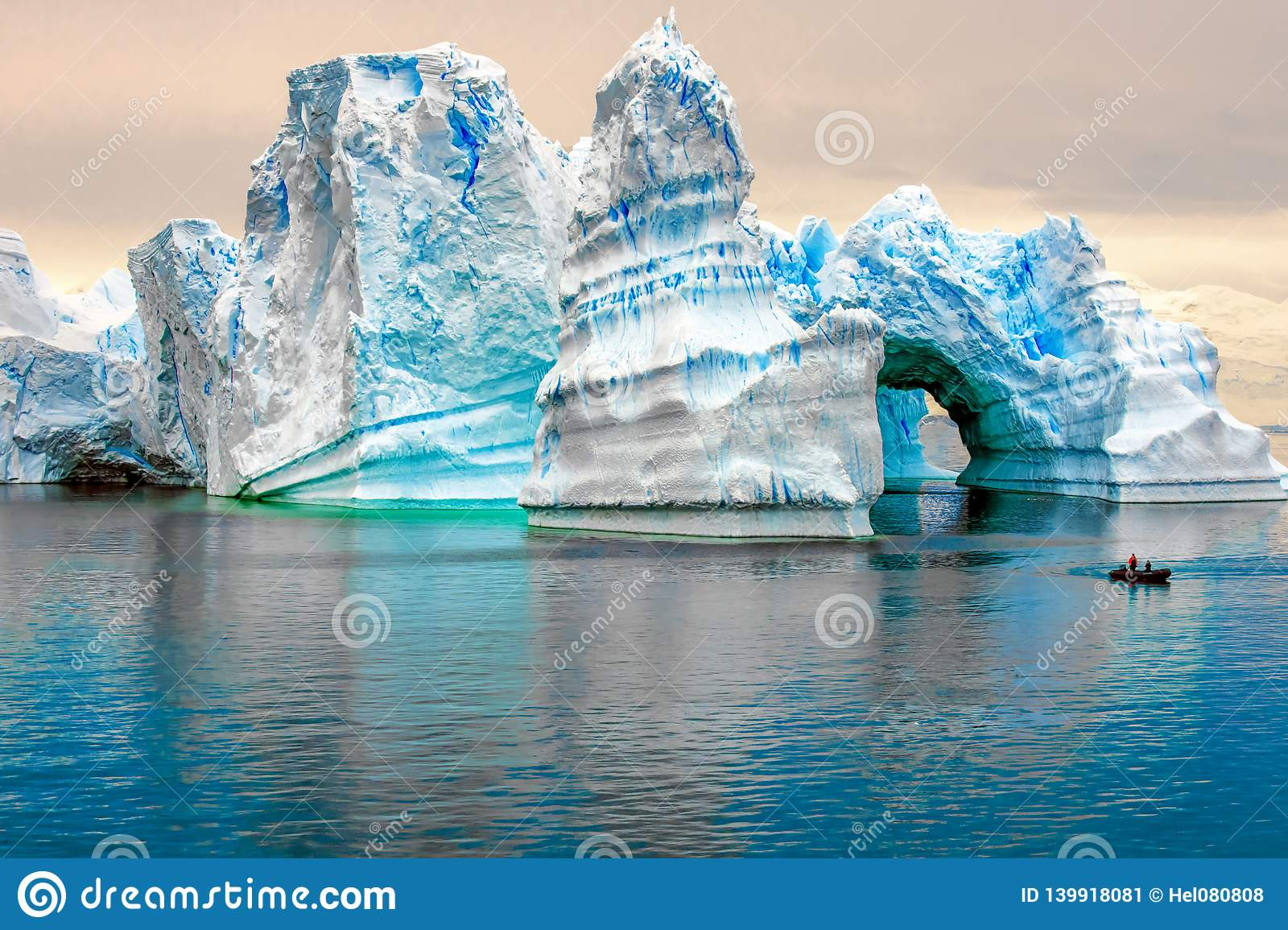 Iceberg in Antarctic, Ice Castle with Zodiac in Front, Iceberg sculptured like fairytale castle