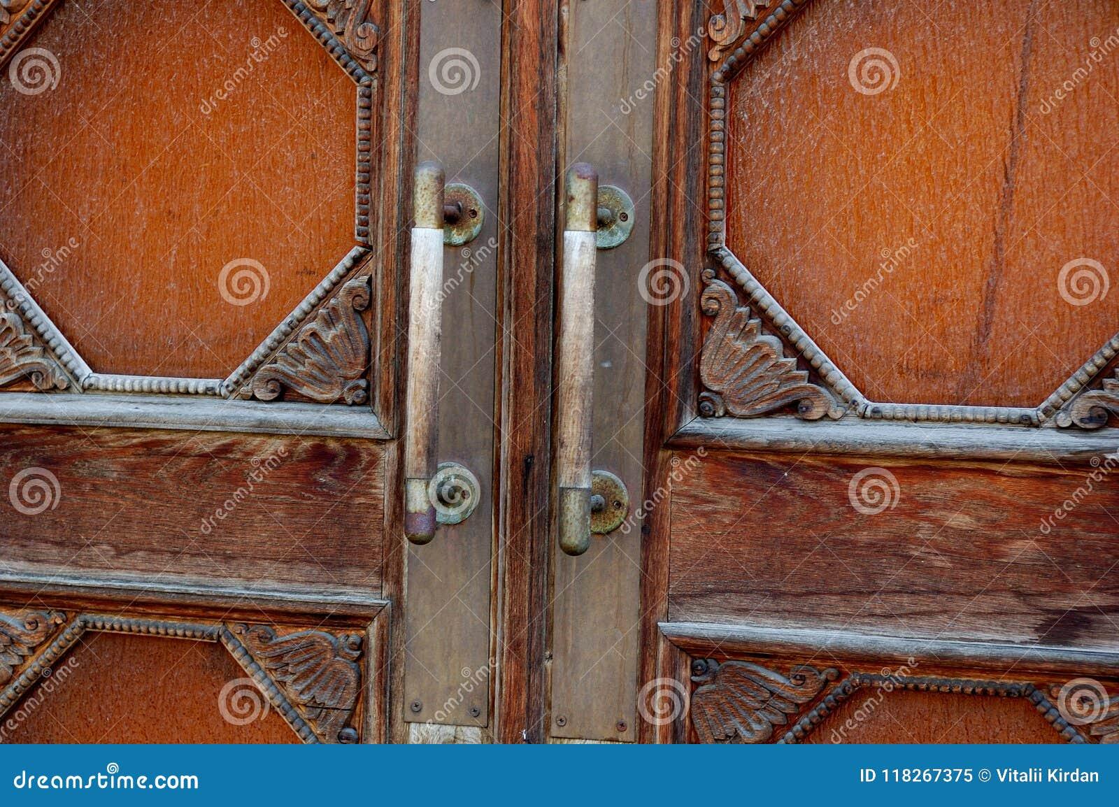 Antique handles on a massive wooden door