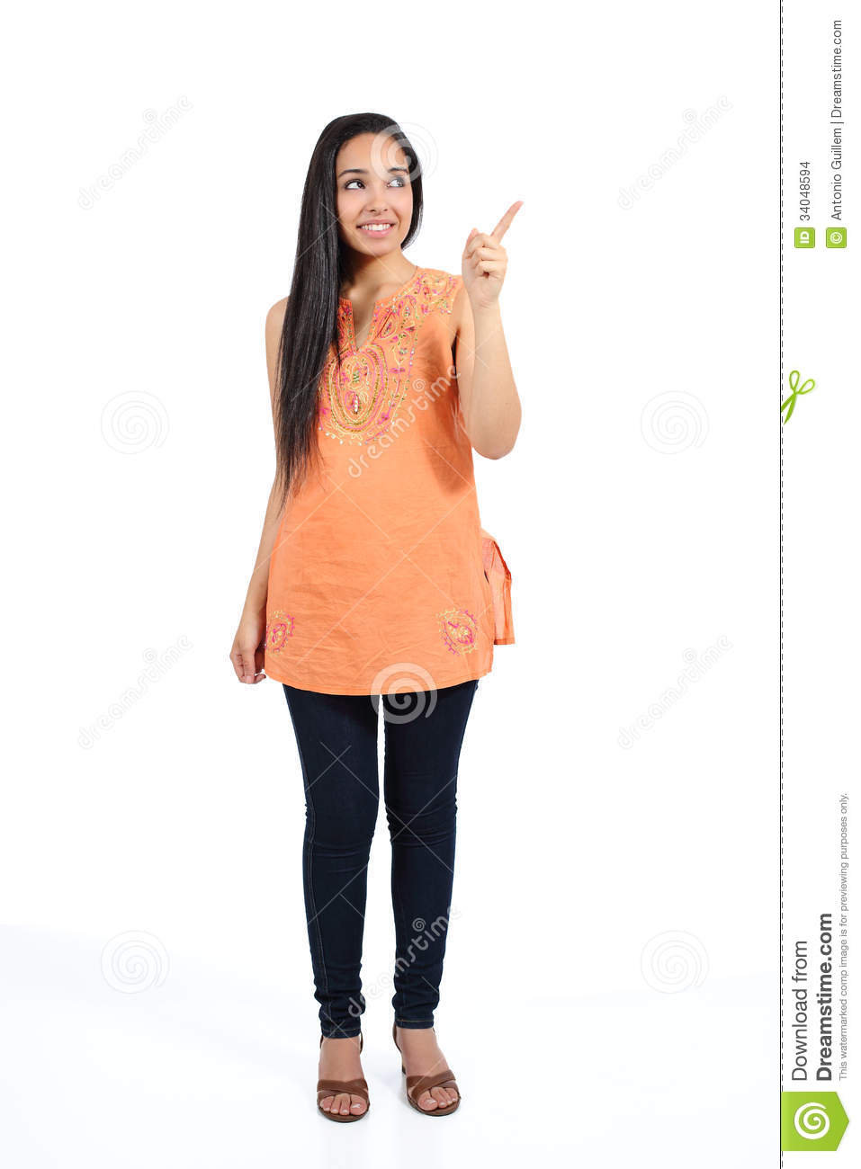 Beautiful arab casual woman pointing above presenting