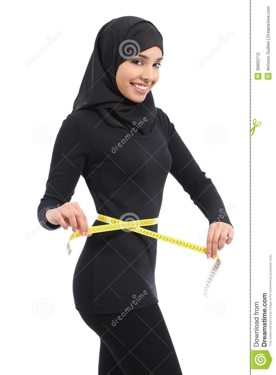 beautiful arab saudi fitness woman measuring her waist with a tape measure stock photography. Black Bedroom Furniture Sets. Home Design Ideas