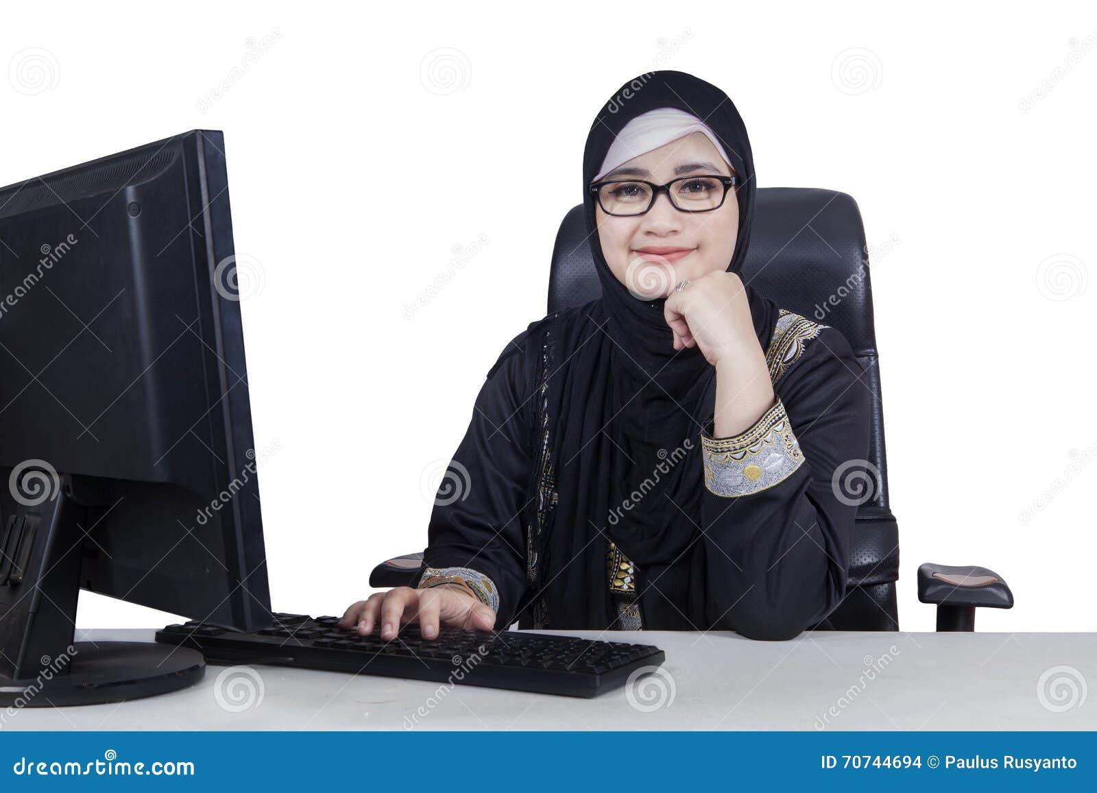 Beautiful Arabian worker smiling at the camera