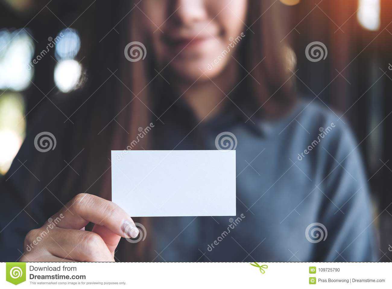 Asian business woman holding and showing empty business card in download asian business woman holding and showing empty business card in office stock photo image colourmoves