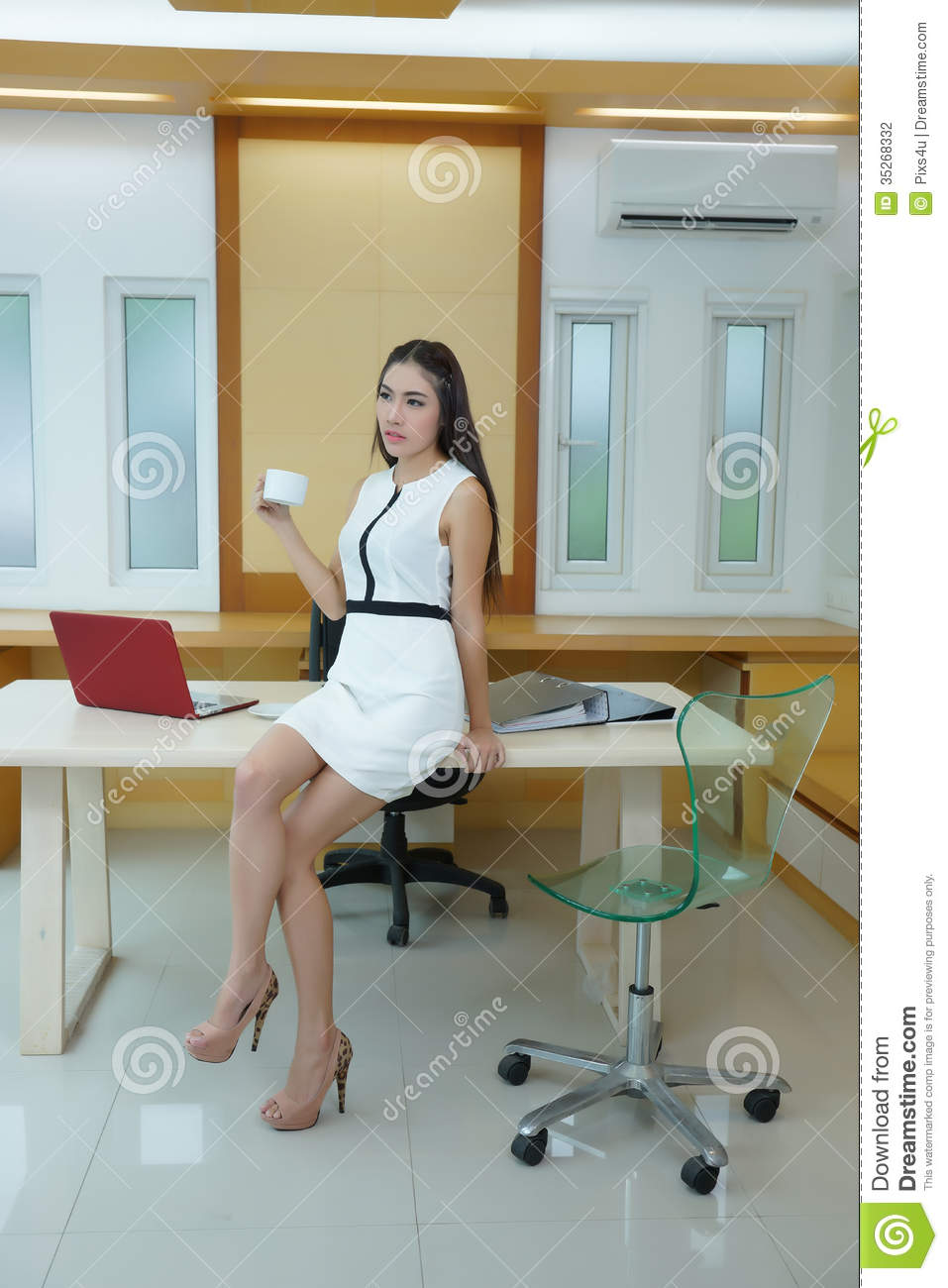 Beautiful Asian Business Woman Standing At Her Desk In