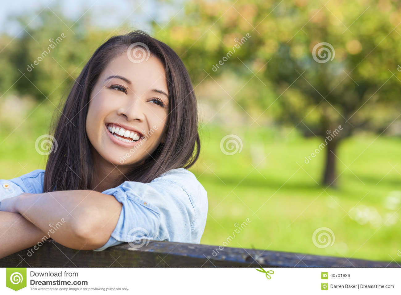 Beautiful happy Asian Eurasian young woman or girl wearing denim shirt ...