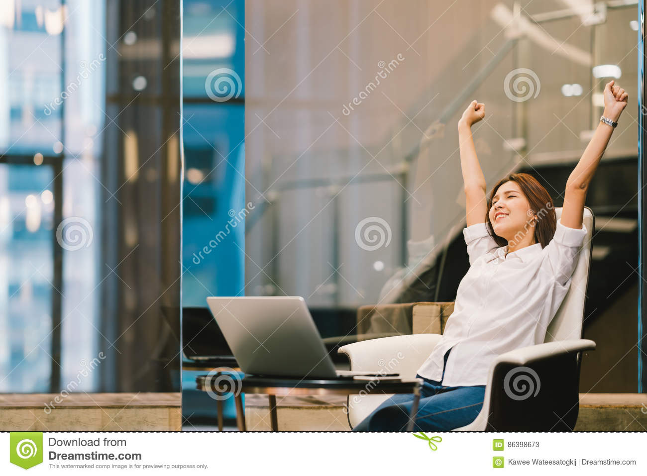 Beautiful Asian girl celebrate with laptop, hands stretch or finish work success pose