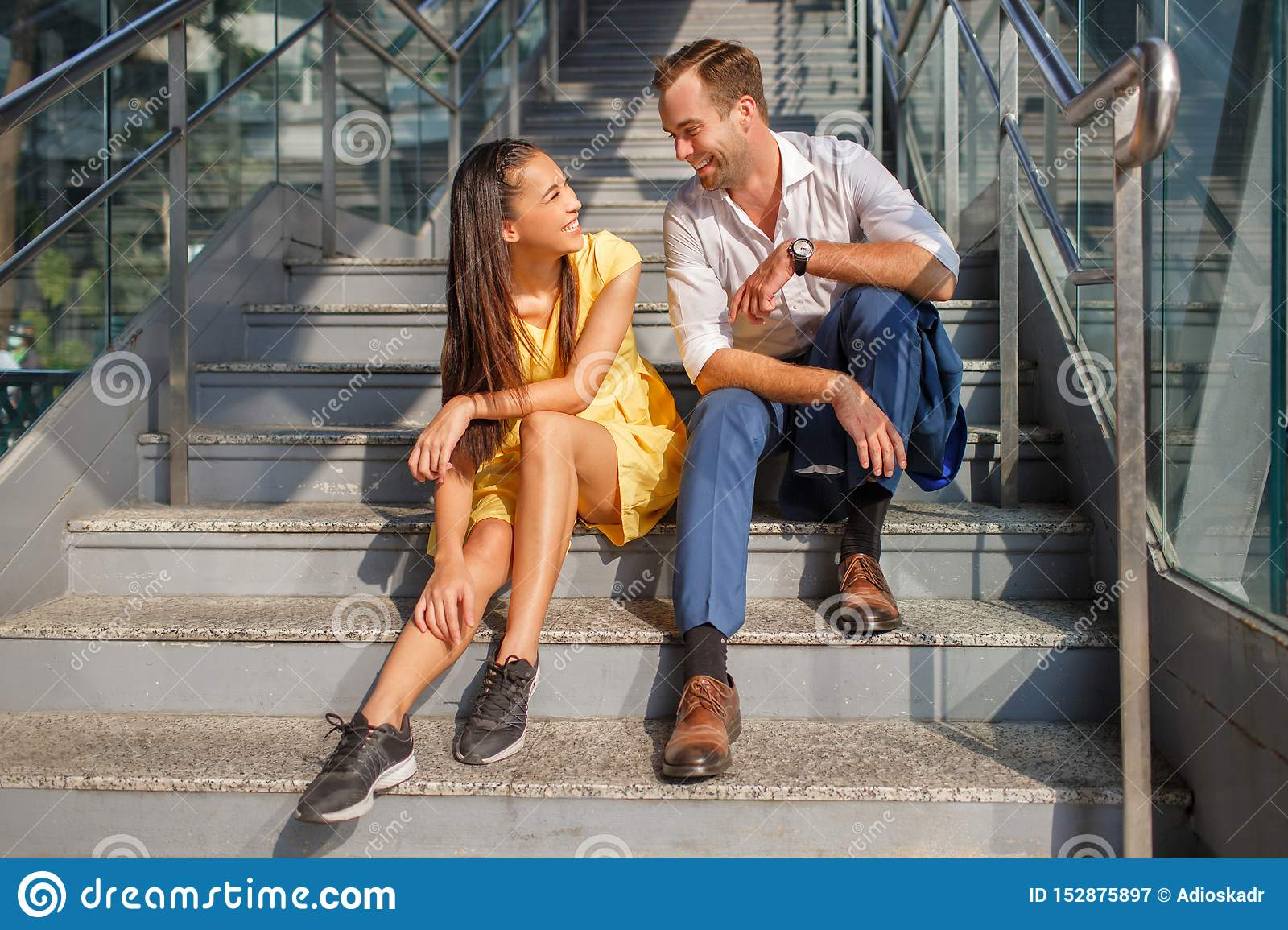 Beautiful asian girl and man together on the street