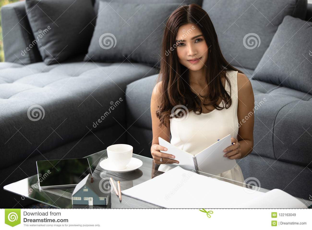 Fabulous Beautiful Asian Girl Smiling Sitting On The Sofa Working Machost Co Dining Chair Design Ideas Machostcouk
