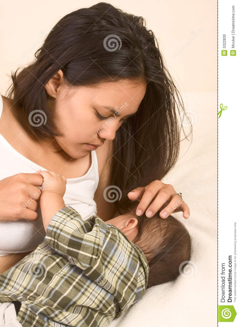 Beautiful Asian mom breastfeeding her baby boy