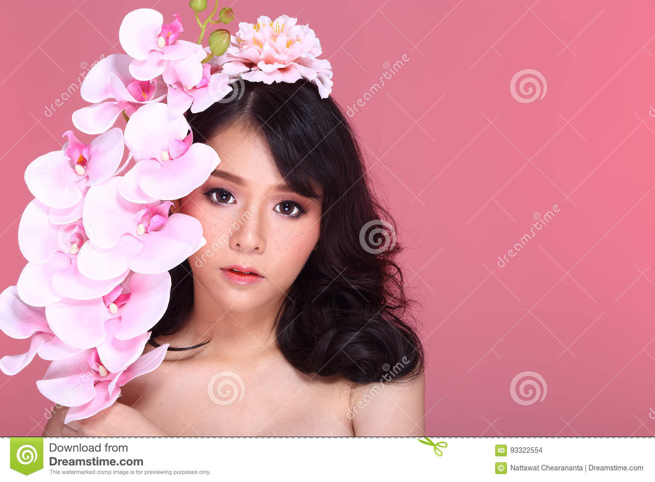 Beautiful Asian Woman black hair with flora crowd, holding bouquet artificial rose over chest