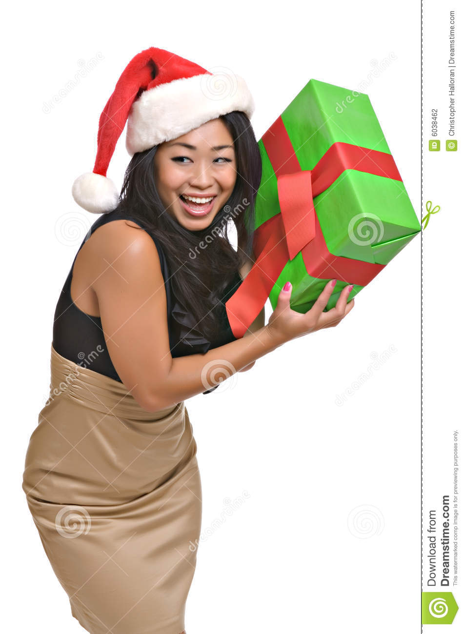 Beautiful Asian woman holds a Christmas gift