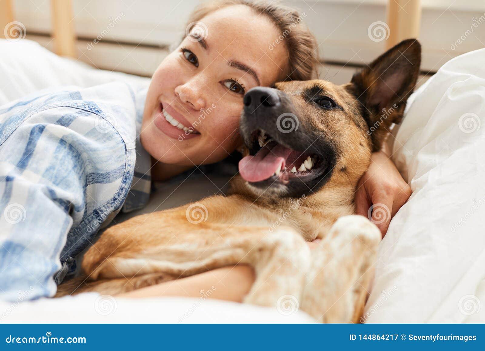 Beautiful Asian Woman Hugging Dog