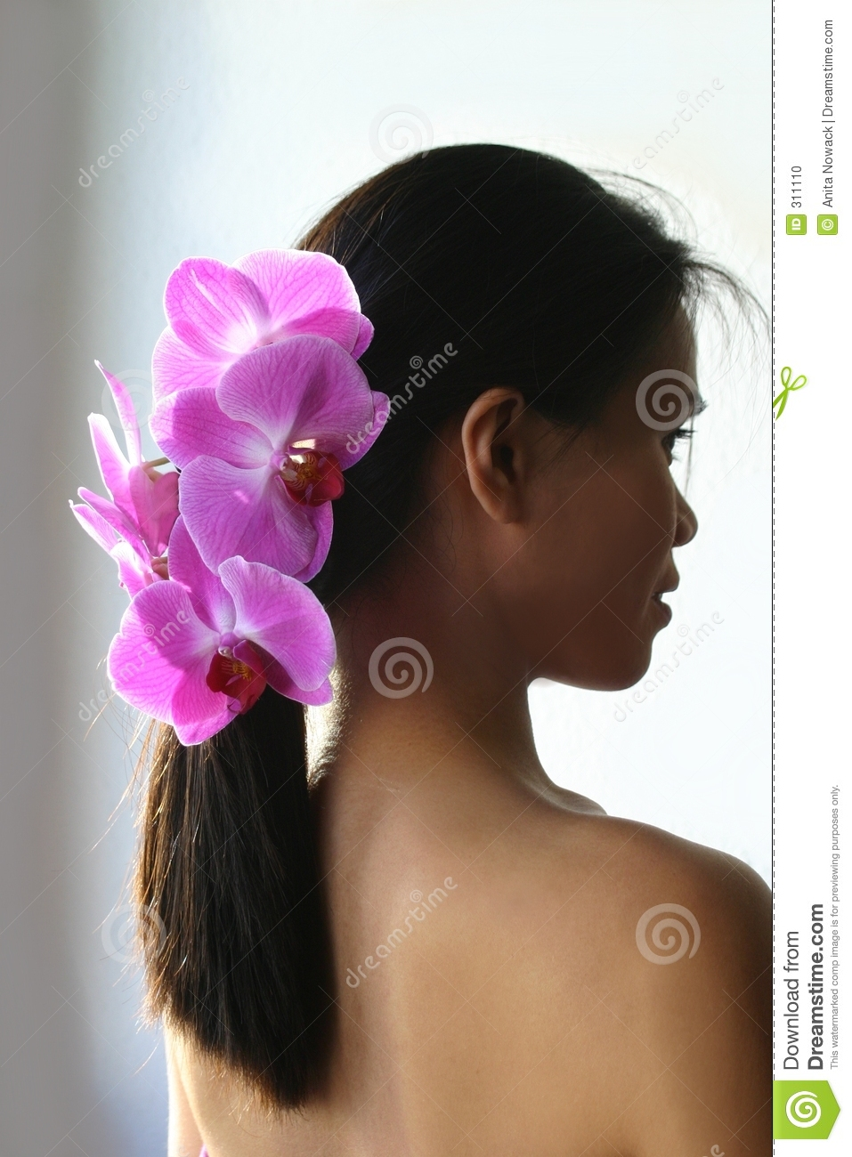 Beautiful Asian woman with orchids on hair