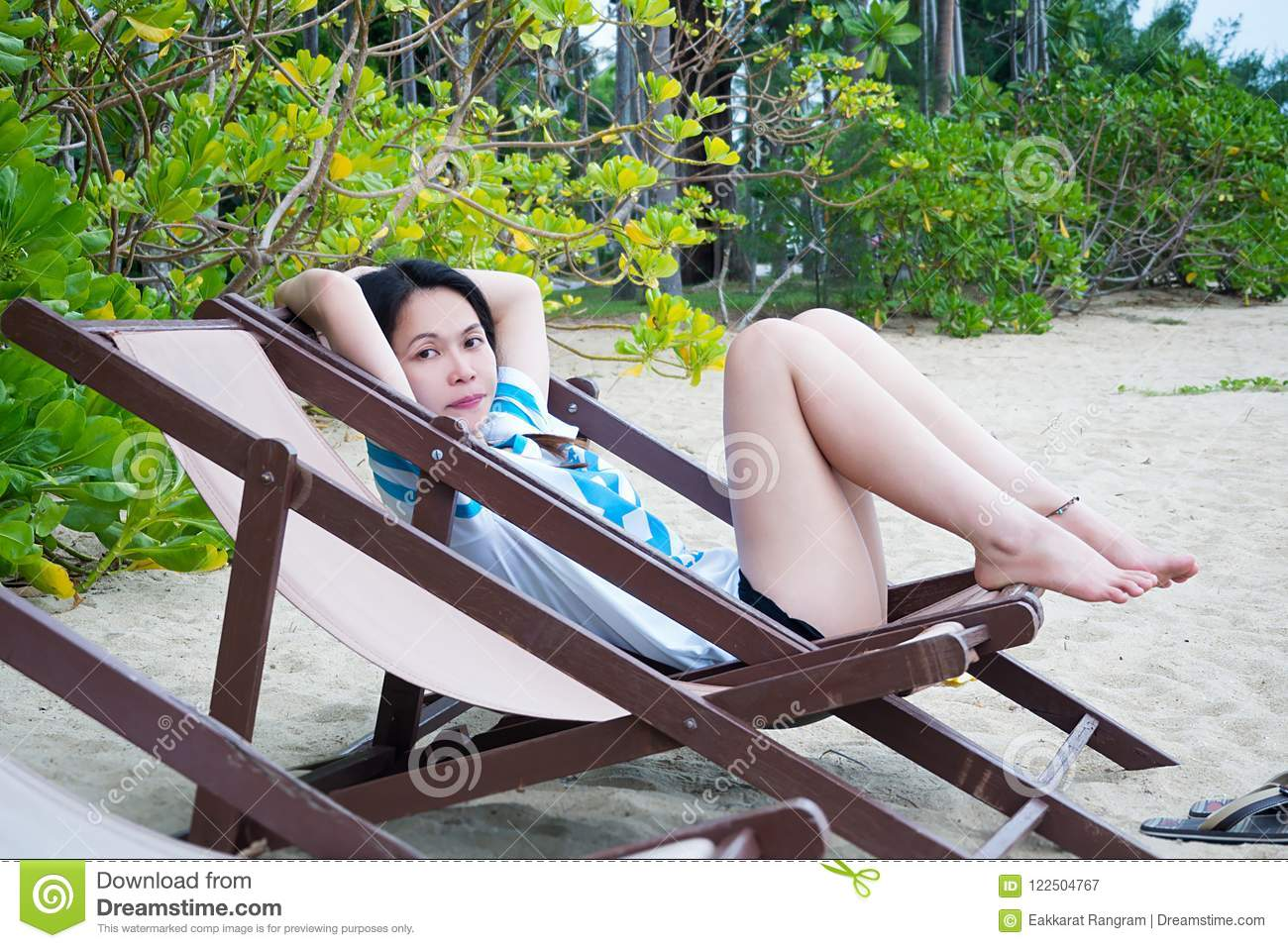 0bd4b07f669 Asian woman relaxing on beach chair in summer vacation on tropical beach.